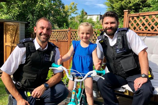 Emily receives her new bike from Pcs Gaydon and Ayling