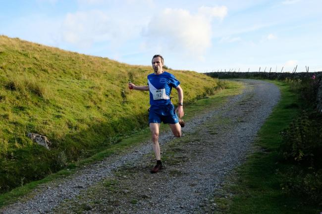 n Cumberland Fell Runners' Ben Opie in full flight on his way to finishing ninth in the Fellside Fell Race in under 59 minutes