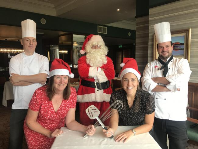 With Father Christmas are Joanne Holborn of Baines Wilson, Abigail Bailey of Barclays, Mark Harris, executive head chef of Lake District Hotels and Shane Hamilton, head chef of the Lodore Falls Hotel