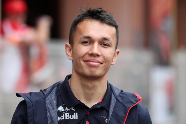 Alex Albon races for Red Bull