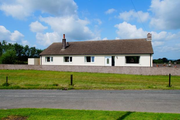 Crossview is a spacious bungalow with large gardens, set back from the road in a rural village and with views of the western Lake District fells