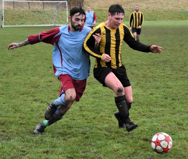 Egremont and District Sunday League. Bransty's Adam Smith battles for the ball in a previous match against Mirehouse, before the coronavirus lockdown. Picture: Ben Challis