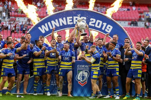 Warrington celebrate winning last season's Coral Challenge Cup Final at Wembley Stadium, London. Picture: PA