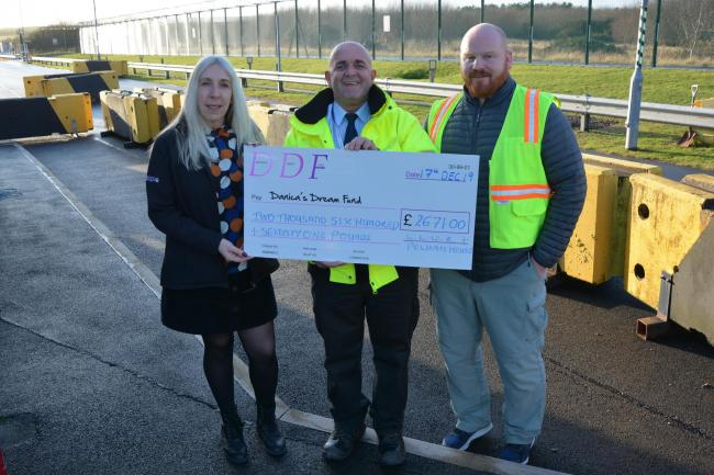 HANDOVER: John Maxwell, centre, is presented with a cheque by LLWR duo Amanda Raynor and Neil Gregg