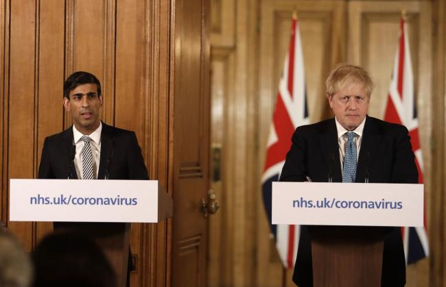 Chancellor Rishi Sunak with Prime Minister Boris Johnson at a coronavirus media briefing in Downing Street earlier this week