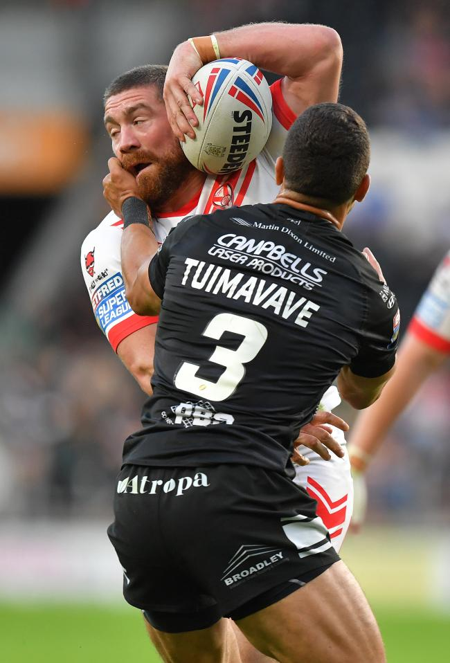 St Helens' Kyle Amor is tackled by Hull FC's Carlos Tuimavave