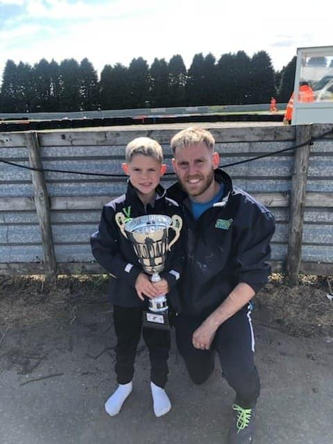 Eight-year-old Oliver Sibbald is continuing to defy expectations as he ends the season with 14 podium finishes from 18 races. Pictured with dad Matthew Sibbald