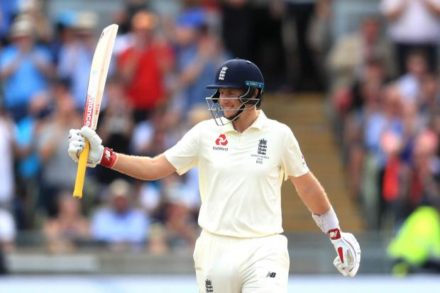 Joe Root celebrates reaching a century