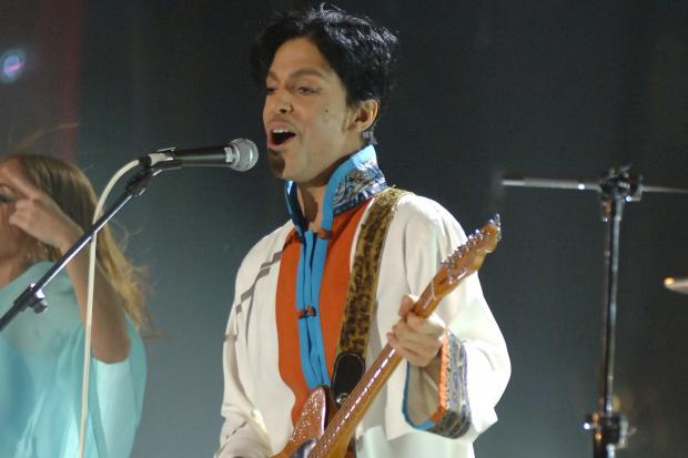 Prince performing on stage at the Brit Awards