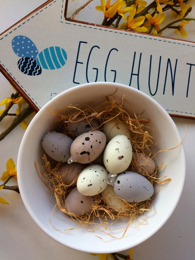 Undated Handout Photo of Hunt Down Style Set of Twelve Speckled Egg Decorations, 3.50; Blue & White Easter Egg Hunt Arrow Sign, 7.50, The Contemporary Home. See PA Feature INTERIORS Easter. Picture credit should read: The Contemporary Home/PA.