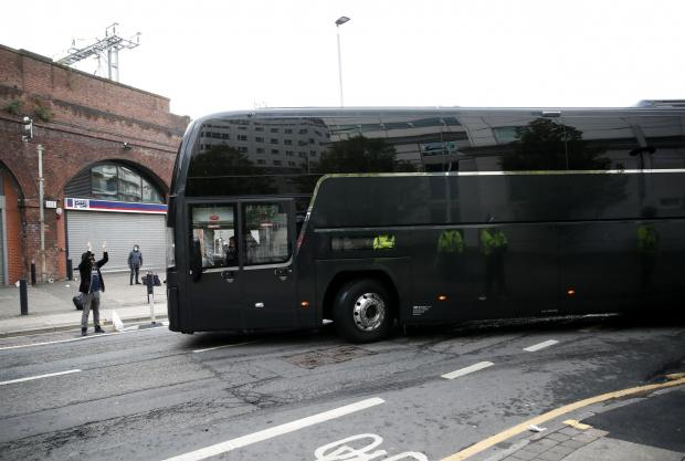 Whitehaven News: Man Utd's team coach leaves the Lowry Hotel after the game against Liverpool was postponed (photo: PA)
