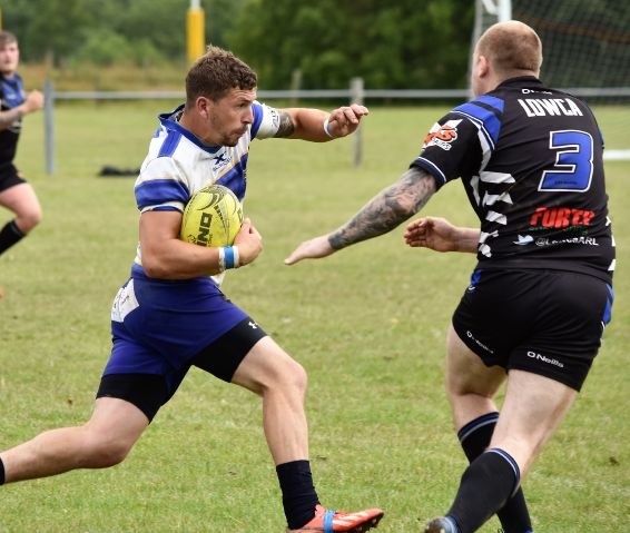 Man-of-the-match: Jack Clark on his way to Cockermouth's first try against Lowca (Photo: Ben Challis)