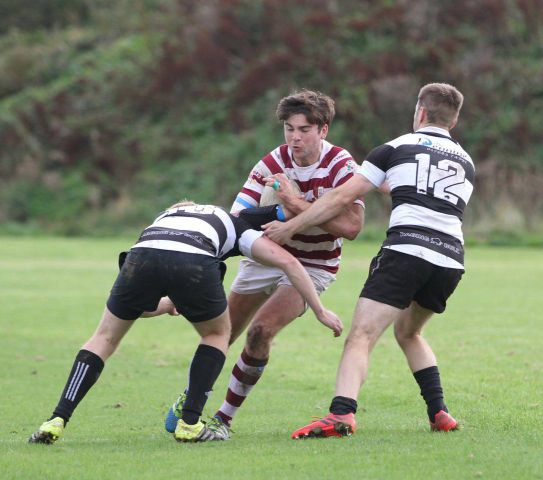 Crunch time: Whitehaven centre Harrison Riley meets two Upper Eden defenders (Photo: Peter Trainor)