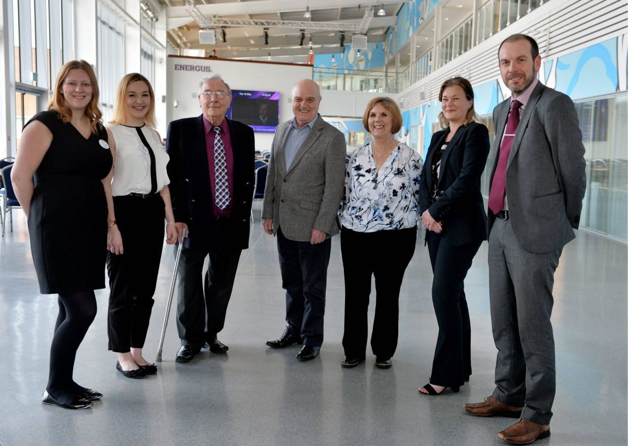 Rebecca Taylor and Rhianna Smith from Energus greet Mind representatives Dr Brian Campbell, Len Davies, Lyn Radcliffe, Liz Sandelands and Gary Carty