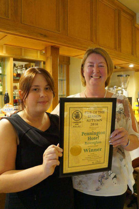 Katie Davidson (left), operations manager at the Pennington Hotel, is presented with CAMRA's award by Donna Mynett, West Cumbria Branch of CAMRA.