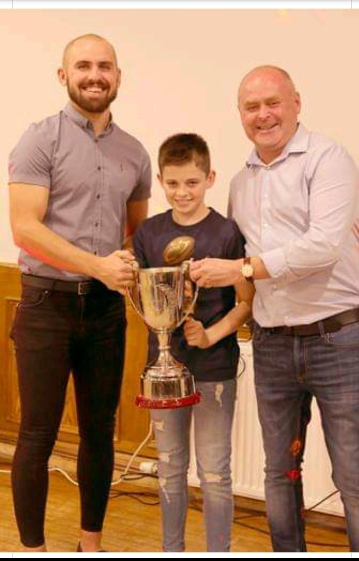 Devan Sharp, centre, with Paul Taylor, right, and Cole Walker-Taylor after receiving the Tommy Taylor Memorial Trophy for youth player of the year at Wath Brow Hornets