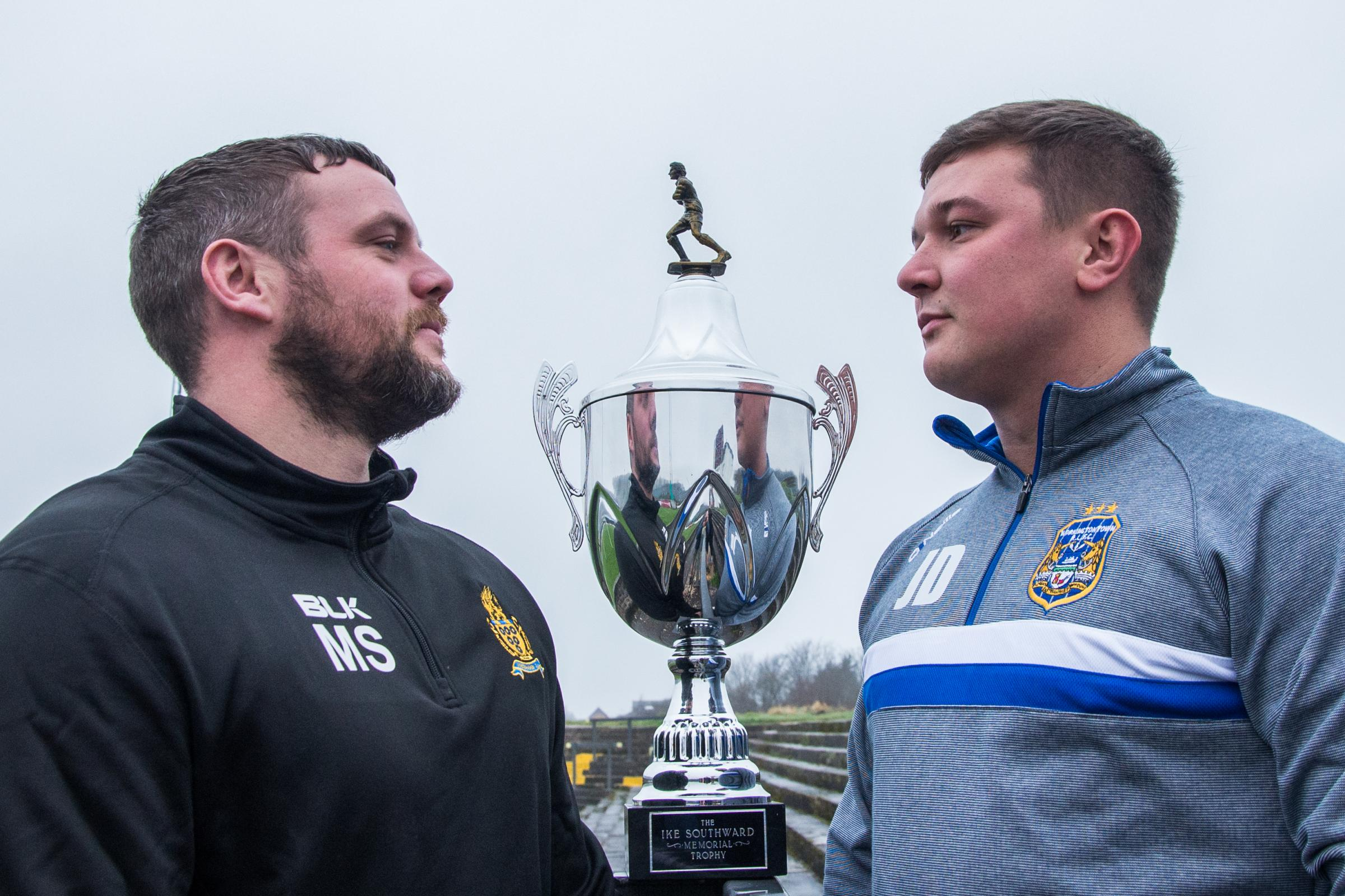 Haven's Marc Shackley and Town's Jamie Doran eyeball each other over the Ike Southward Memorial Trophy that the two teams play for on Sunday					Picture: Gary McKeating