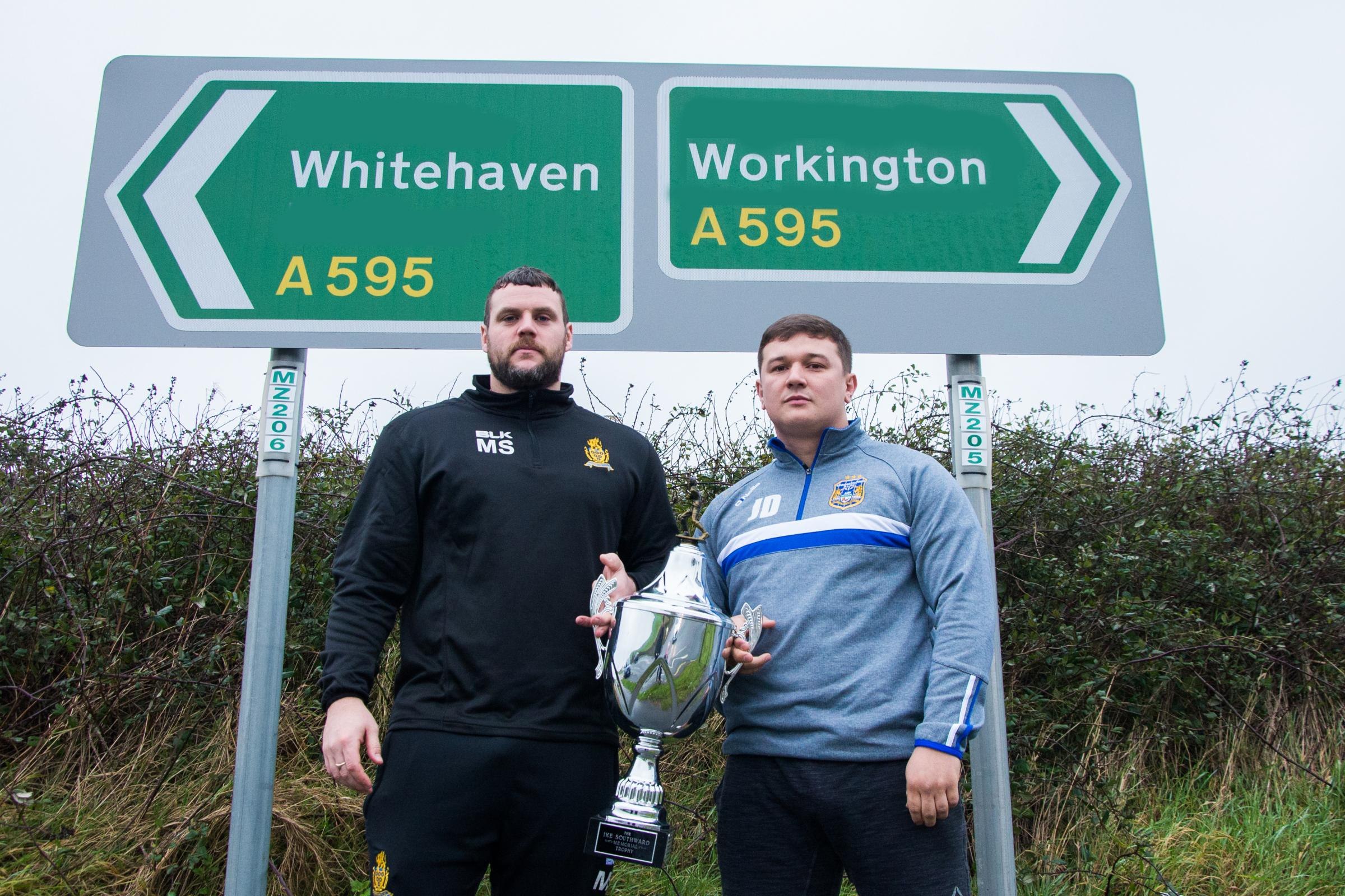 DERBY DAY: Marc Shackley and Jamie Doran with a little doctoring of the road signs! 	                         Gary McKeating