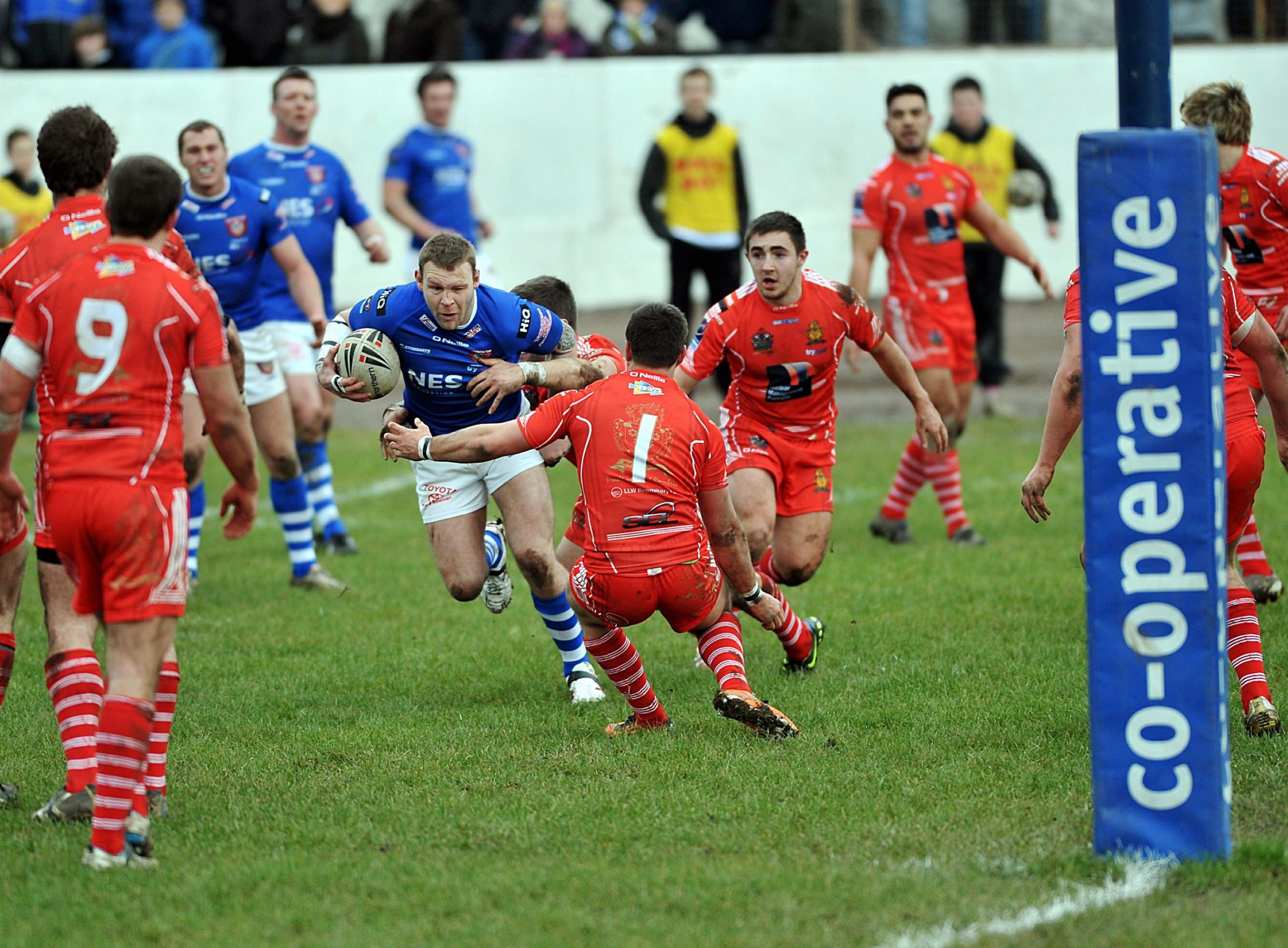 CUMBRIA RETURN: Jamie Thackray on the charge for Workington Town in 2012                                                  Tom Kay