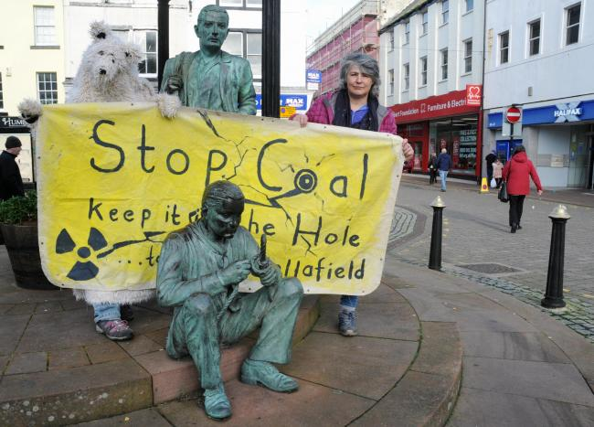 keep Cumbria Coal in the Hole. Polar Bear Tearing Up The Paris Climate Agreement at West Cumbria Mining Offices, Near Haig Pit. 22 Feb 2019. Pics Jim Davis...The polar bear and  Marianne Birkby, in Whitehaven's Market Place..