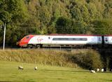 A Virgin Pendolino train travels along the railway line near Wreay on the West Coast Mainline in Cumbria: 15 October 2012..STUART WALKER 50039813F012.JPG.